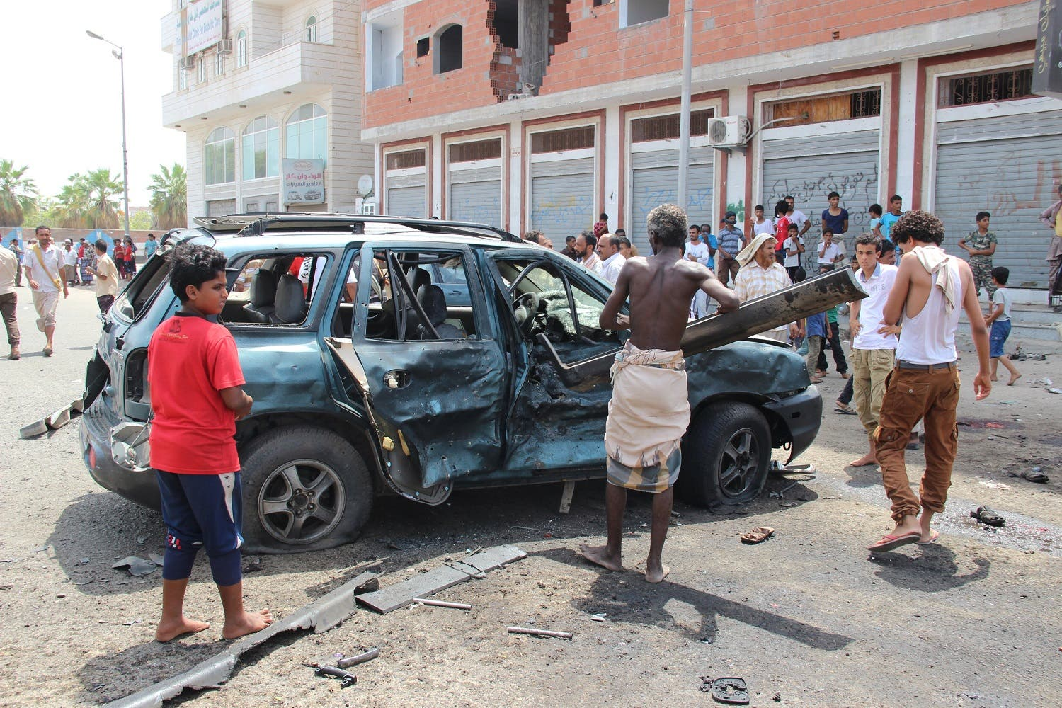 People check the site of a suicide bombing in the southern port city of Aden. (Reuters)