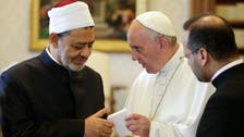 Pope and top imam hug in historic meeting