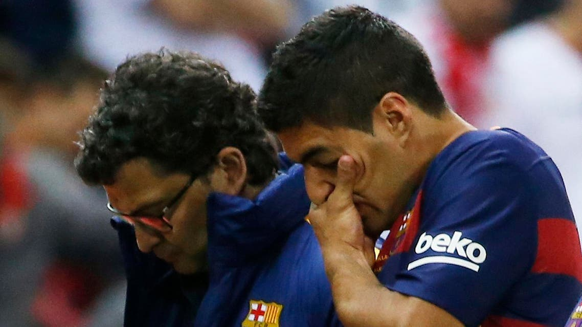 Suarez is expected to undergo tests Monday to find out the extent of the right leg injury that forced him to limp off the pitch against Sevilla. (Reuters)