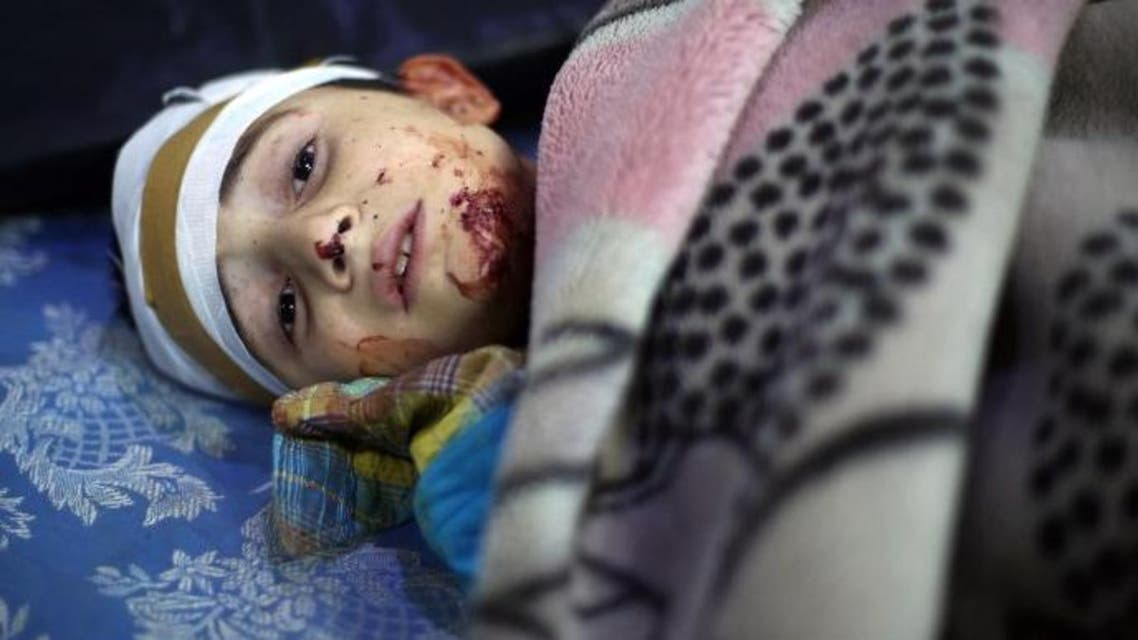 A wounded Syrian boy looks on at a makeshift hospital, following reported Syrian government air strikes on the rebel-held town of Arbin in the eastern Ghouta region on the outskirts of the capital Damascus, on May 9, 2016.  (AFP)