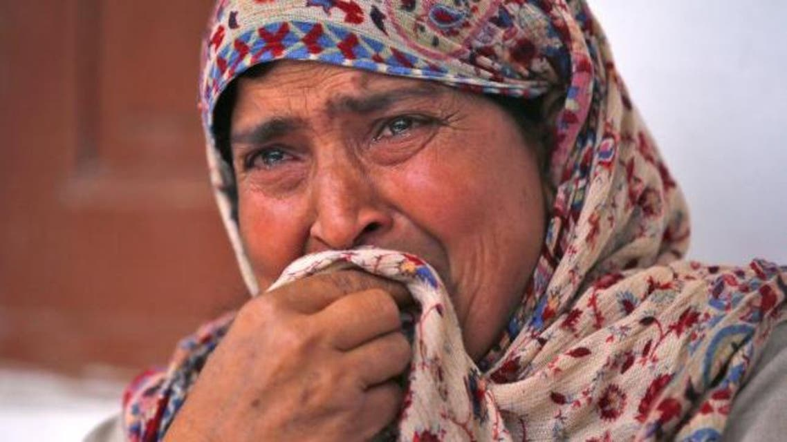Rafiqa, mother of Shaista Hameed who was killed by a stray bullet during an encounter, cries during an interview with Reuters in Lalhar, south of Srinagar May 16, 2016. (Reuters)