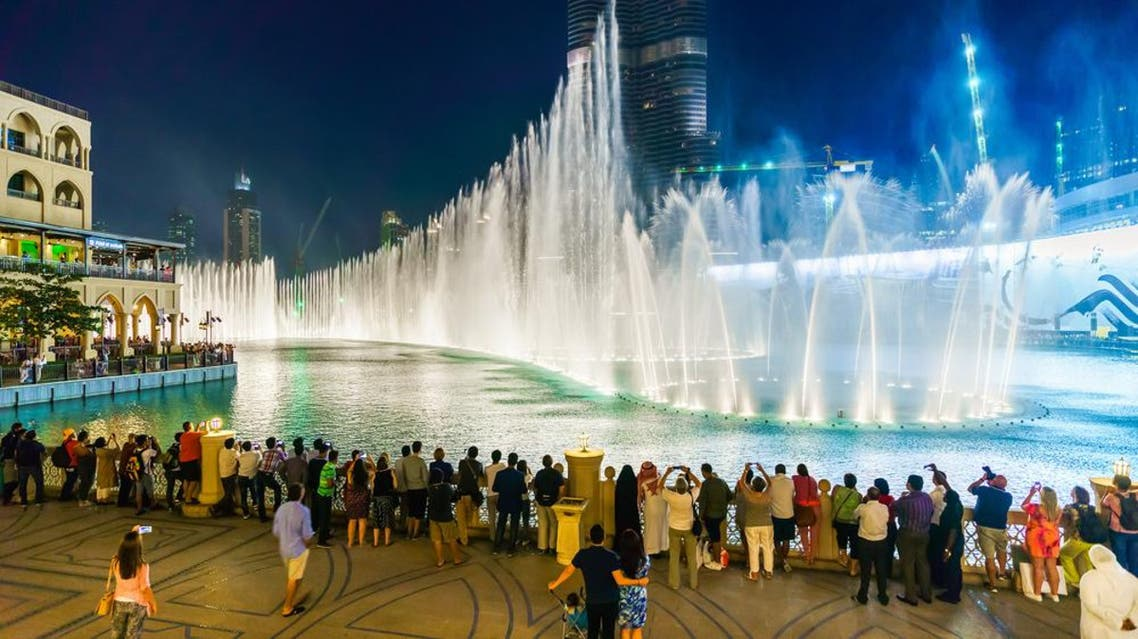 People watch a fountain display at an upscale shopping mall in Dubai, the United Arab Emirates. Jones ranks the UAE as being among the world's top ten happiest countries. (Shutterstock)