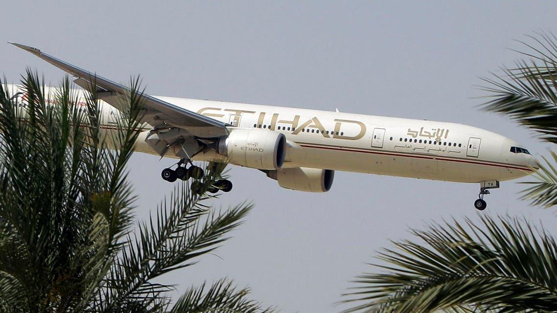 In this Sunday, May 4, 2014 file photo, an Etihad Airways plane prepares to land in Abu Dhabi Airport, United Arab Emirates. (AP)