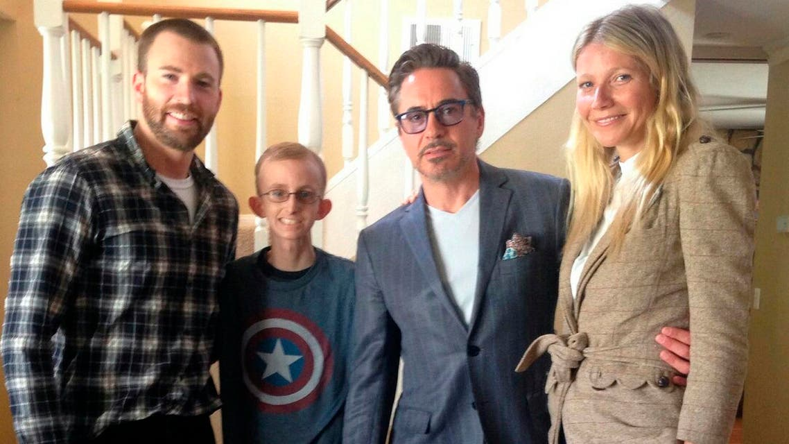 Iron Man Robert Downey Jr. joined Captain America Chris Evans to visit 18-year-old Ryan Wilcox at his home in Southern California. (AP)