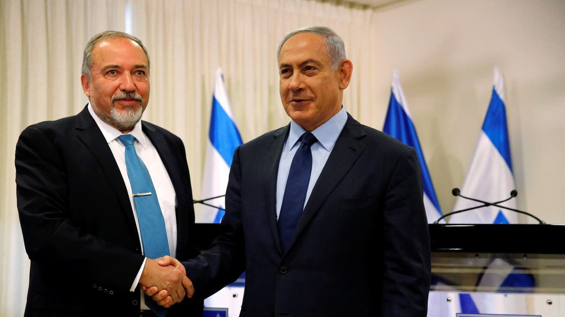Avigdor Lieberman, head of far-right Yisrael Beitenu party, (L) and Israeli Prime Minister Benjamin Netanyahu deliver statements to the media after signing a coalition deal to broaden the government's parliamentary majority, at the Knesset, the Israeli parliament in Jerusalem May 25, 2016. (Reuters)