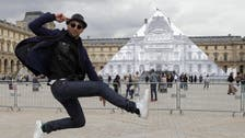 Artist makes Louvre Pyramid disappear in optical illusion