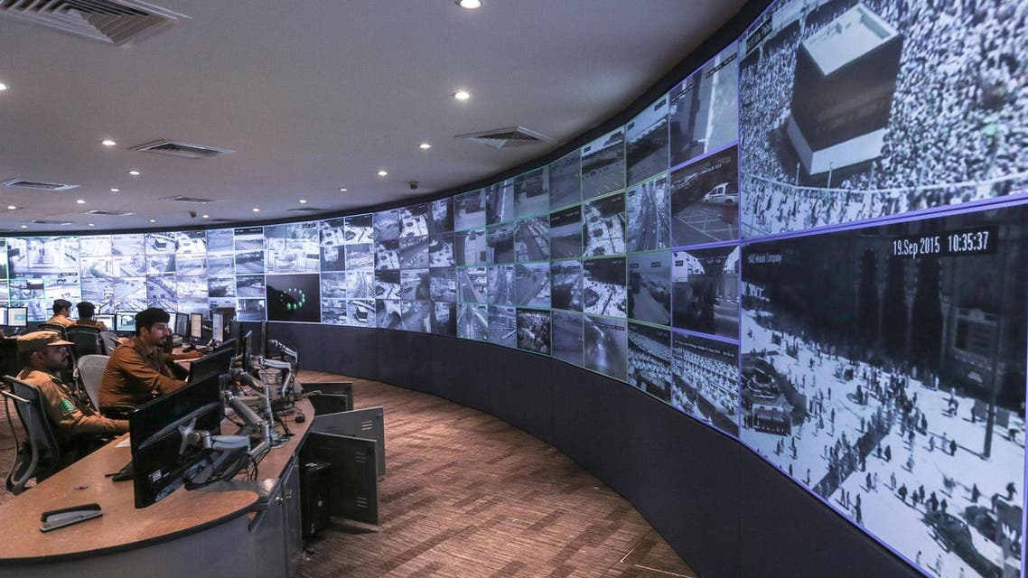 Four members of the government's 100,000-strong security force keep an eye on just a handful of the 5,000 CCTV cameras operating in Makkah. (File photo: AP)