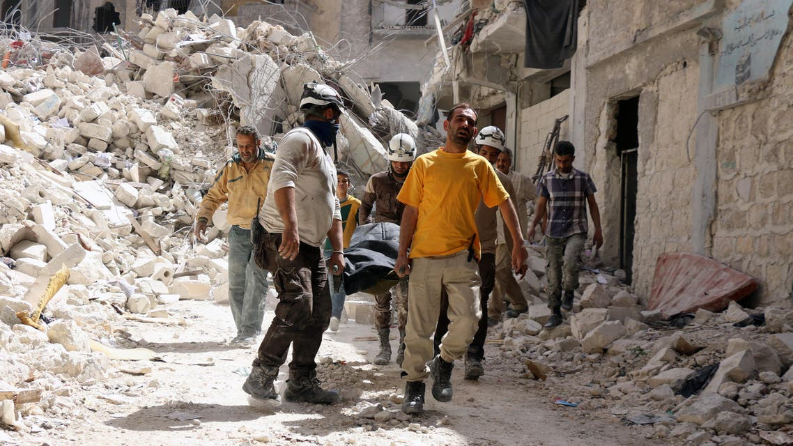Syrian Civil Defence workers evacuate a body following a regime air strike on May 17, 2016, in the rebel-held al-Sukari neighborhood of the northern city of Aleppo. (AFP)