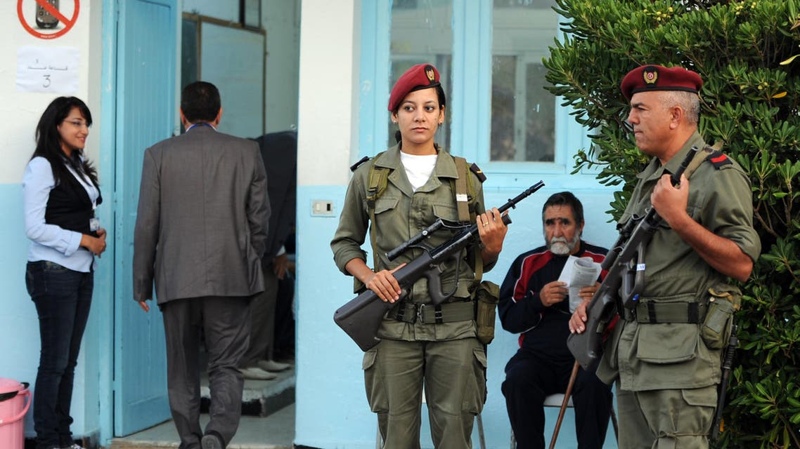 Soldiers stand guard on October 23, 2011 outside a polling station in Tunis.