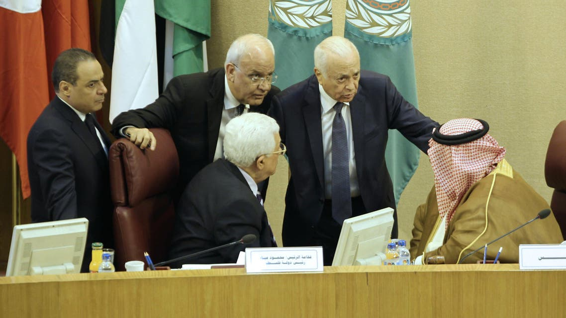 Palestinian president Mahmud Abbas (C-L) and Palestinian chief negotiator, Secretary General of the Palestine Liberation Organisation (PLO), Saeb Erekat (2-L), Arab League Secretary General Nabil al-Arabi (2-R) and Bahrain's Foreign Minister Khalid bin Ahmed al-Khalifa (R) speak during a meeting of Arab foreign ministers to discuss a French peace initiative in the Egyptian capital Cairo, on May 28, 2016. AFP