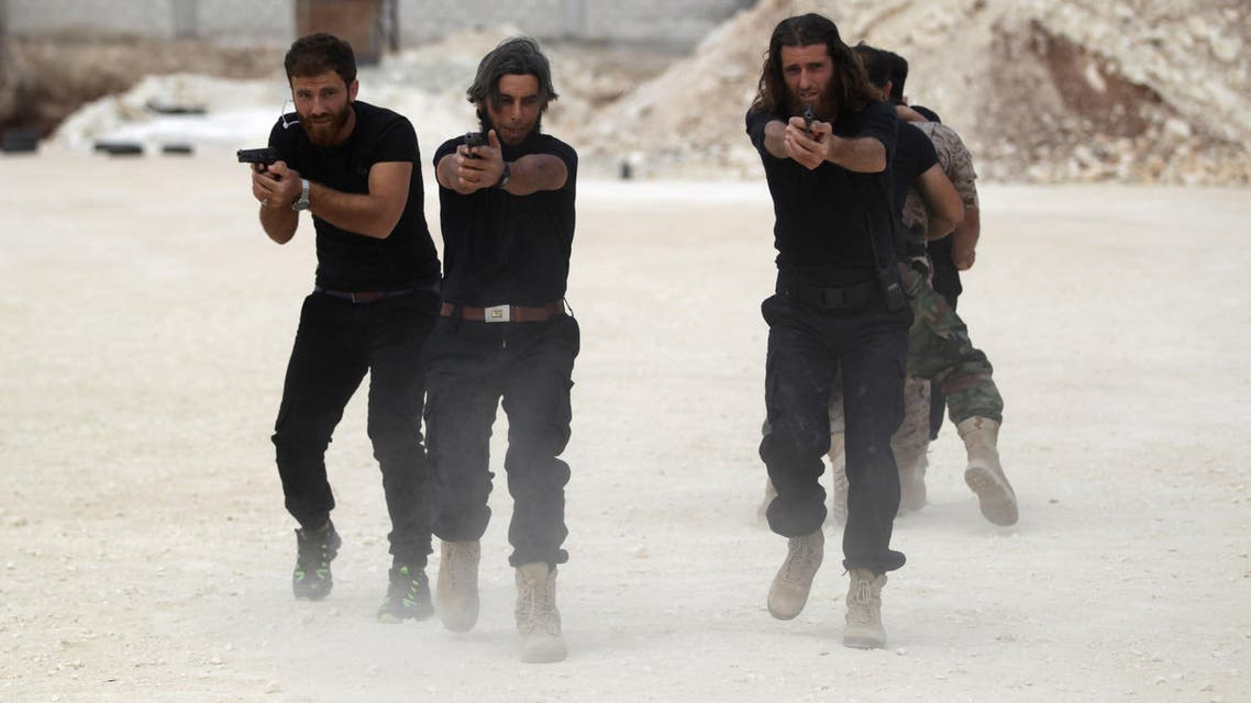 Free Syrian Army fighters celebrate at graduation ceremony
