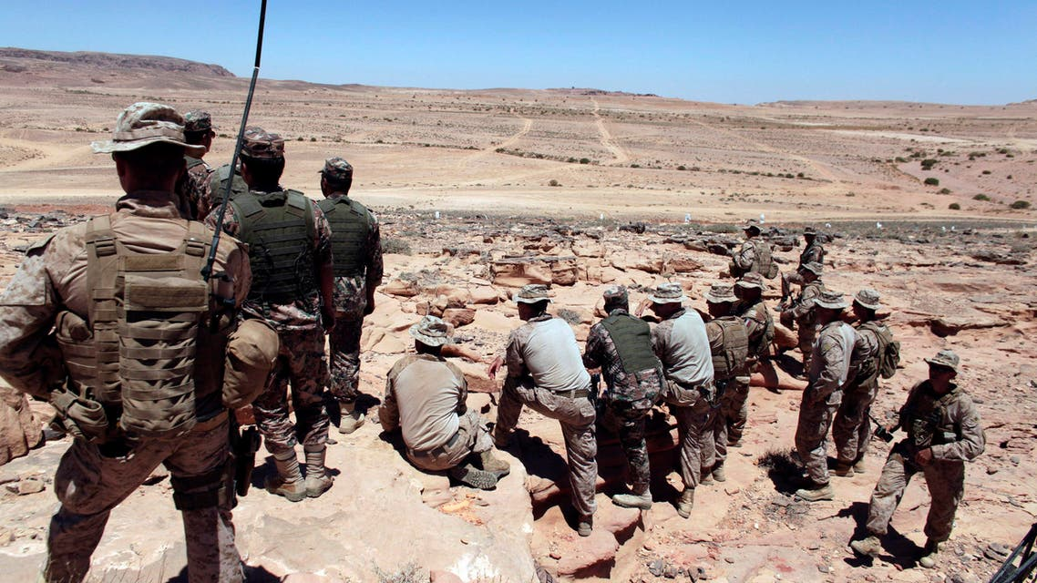 In this June 18, 2013, file photo, U.S. Marines monitor Eager Lion multinational military maneuvers in Quweira, south of Amman, Jordan. After months of delays and vetting, the training of Syrian rebels has started in Jordan as part of a broader effort to build a force capable of fighting Islamic State extremists AP