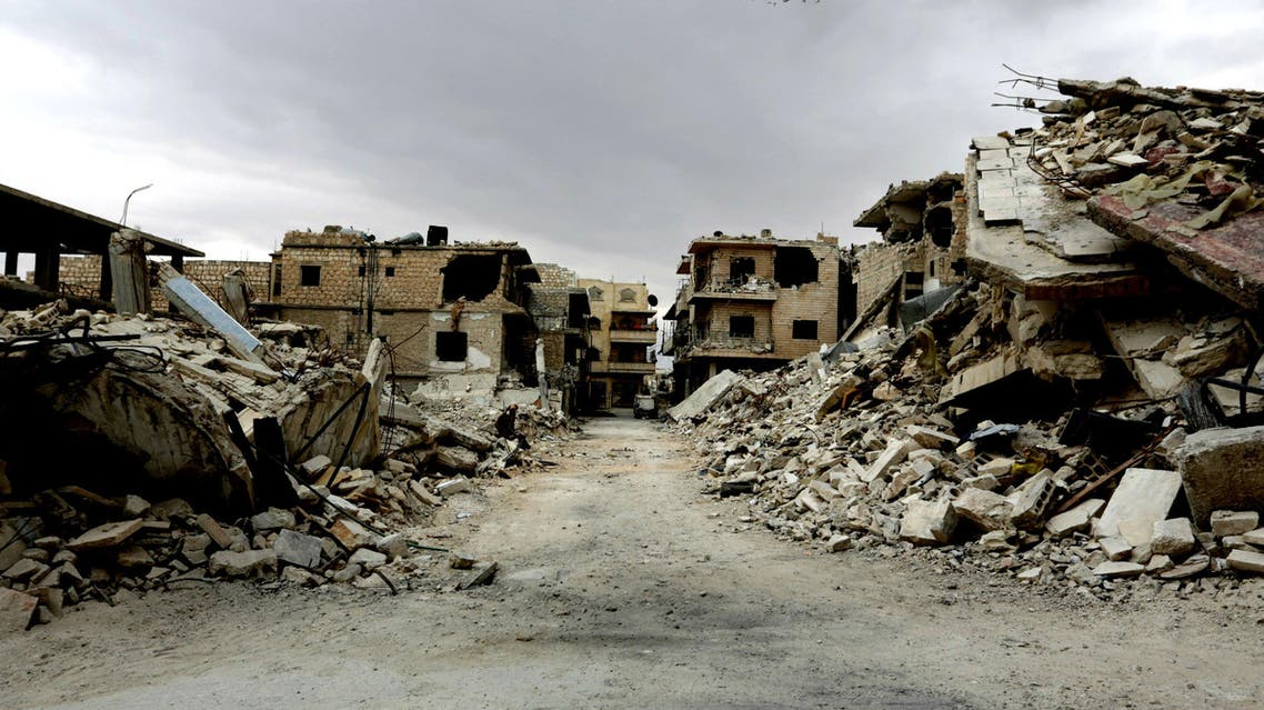 Birds fly over a damaged neighbourhood, in the rebel-controlled area of Maaret al-Numan town in Idlib province, Syria May 23, 2016. (Reuters)
