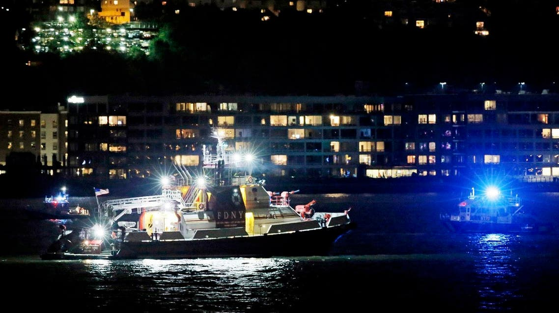 An FDNY fire department boat searches the Hudson River for the wreckage of a vintage P-47 Thunderbolt airplane that crashed in the river in New York City. (Reuters)