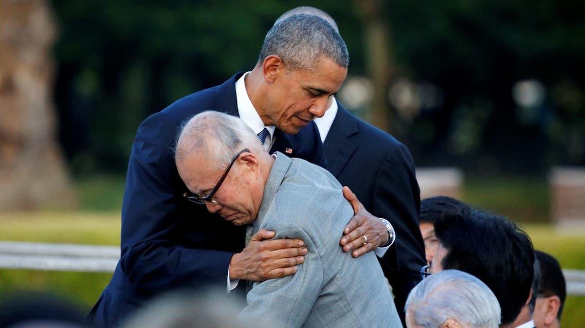 Obama hugs with atomic bomb survivor Shigeaki Mori as he visits Hiroshima Peace Memorial Park in Hiroshima. (Reuters)