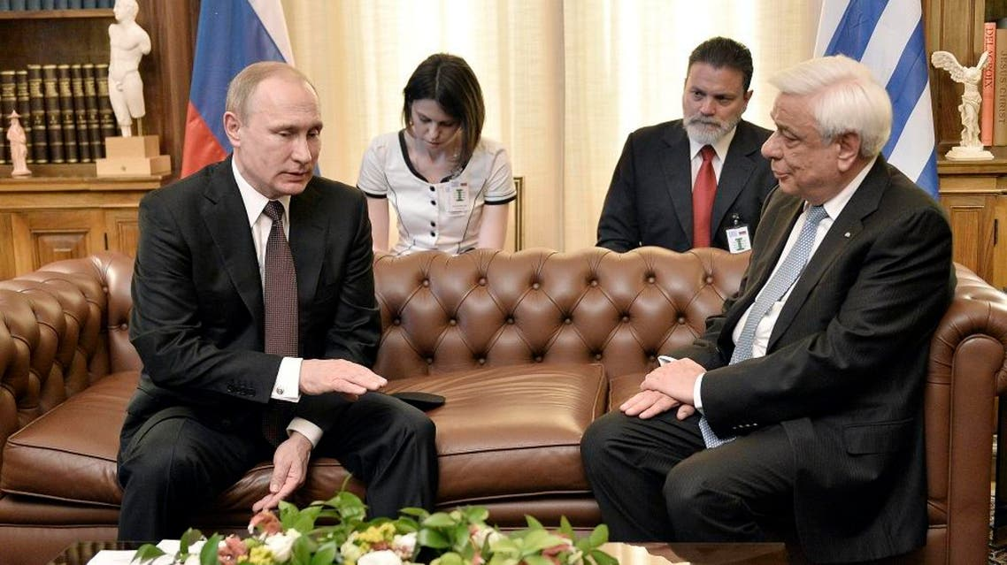 Putin wraps up Greek trip with Russian monastery visit REUTERS