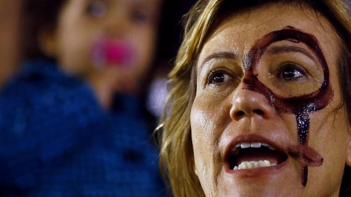 A woman attends a protest against rape and violence against women in Rio de Janeiro. (Reuters)