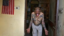 Indian man removes teeth and gets over 500 tattoos