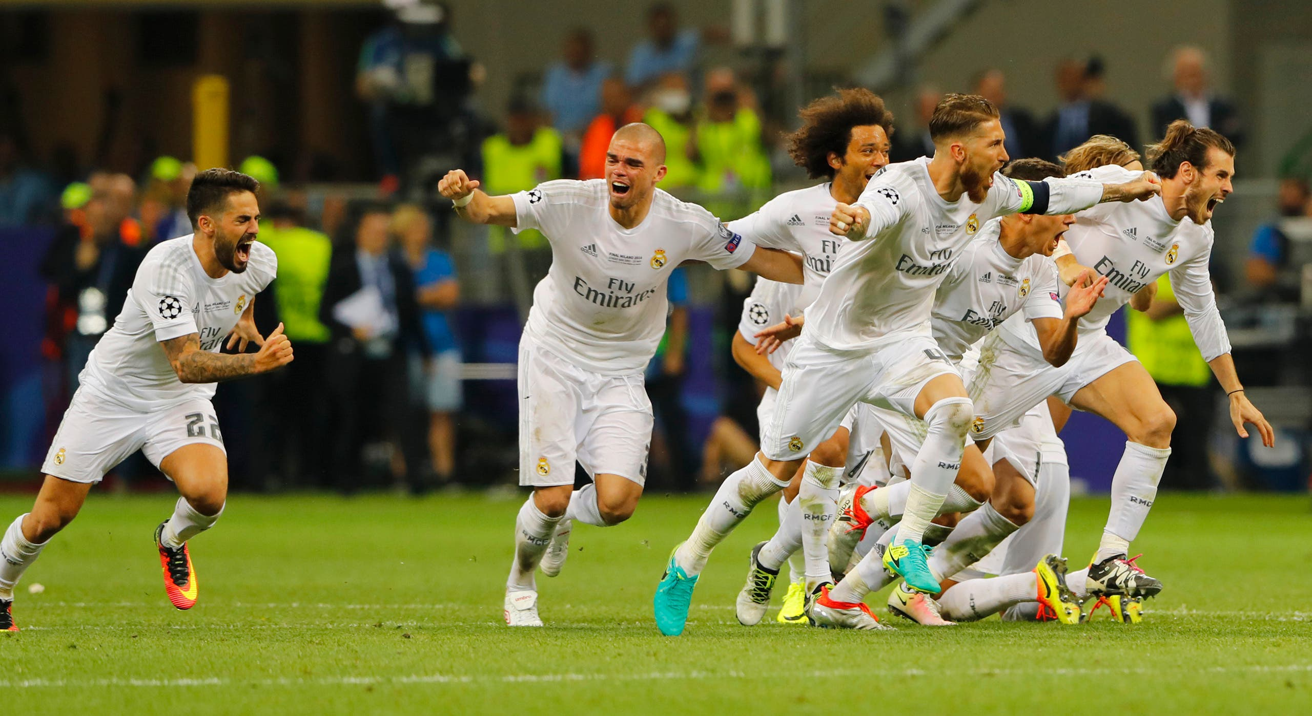 Real Madrid players celebrate after Cristiano Ronaldo scores the winning penalty reuters