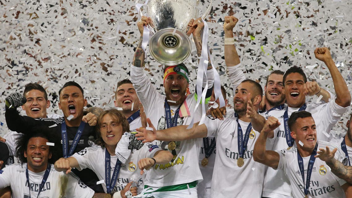 Real Madrid's Sergio Ramos lifts the trophy as they celebrate winning the UEFA Champions League Reuters