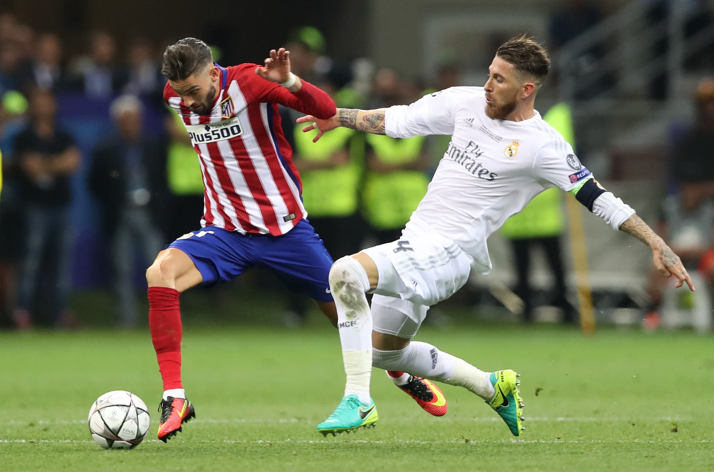Real Madrid's Sergio Ramos fouls Atletico Madrid's Yannick Ferreira Carrasco resulting in a yellow card to Ramos reuters