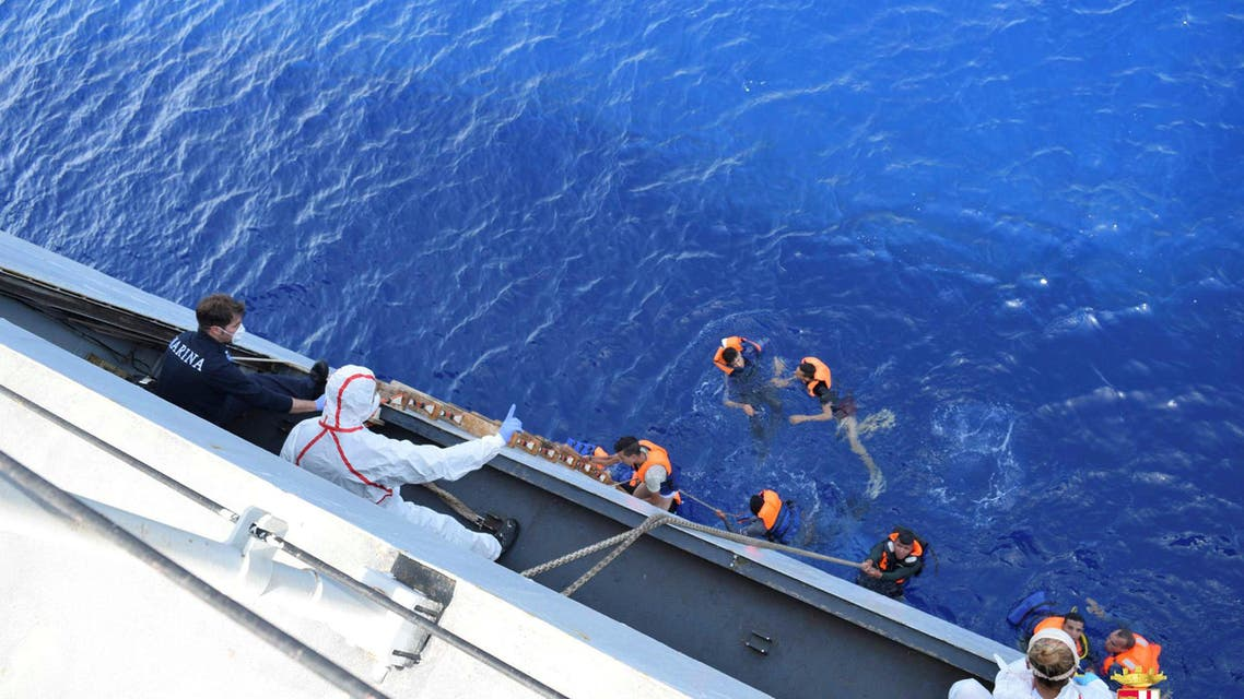 """Migrants from a capsized boat are rescued during a rescue operation by Italian navy ships """"Bettica"""" and """"Bergamini"""" off the coast of Libya in this handout picture released by the Italian Marina Militare on May 25, 2016. (Reuters)"""
