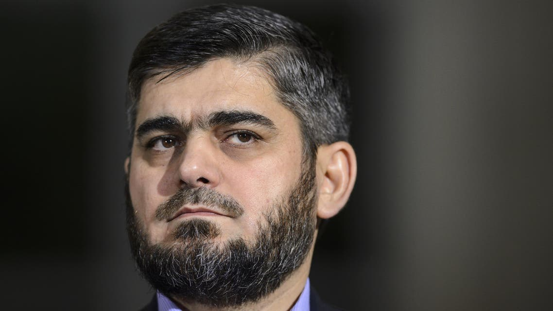 Chief negotiator for the main Syrian opposition umbrella group the High Negotiations Committee (HNC), Army of Islam rebel group's Mohammed Alloush looks on during a press conference following peace talks at the United Nations Office in Geneva on April 13, 2016. (AFP)
