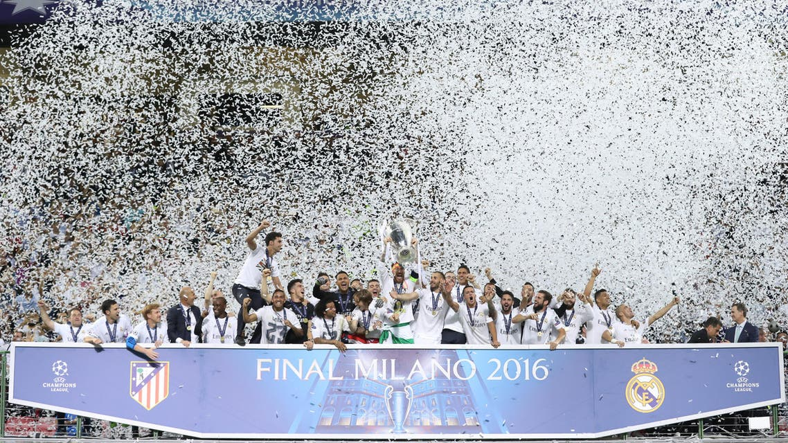 Real Madrid's Sergio Ramos lifts the trophy as they celebrate winning the UEFA Champions League. (Reuters)