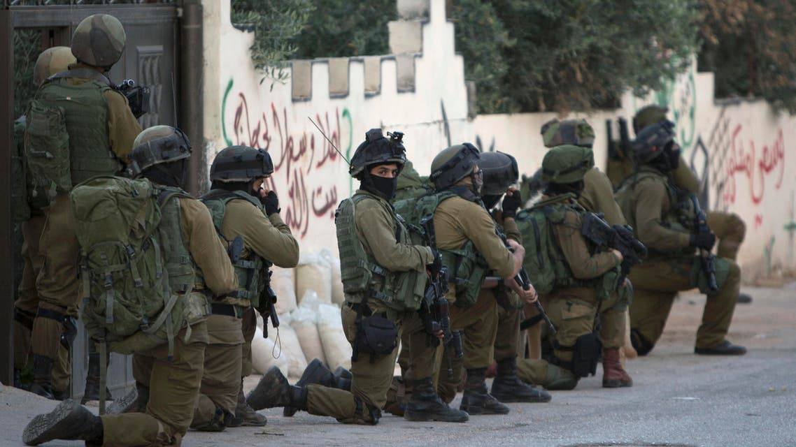 Israeli troops deploy during an army operation at West Bank village of Salem, near Nablus, Monday, May 30, 2016. (AP)