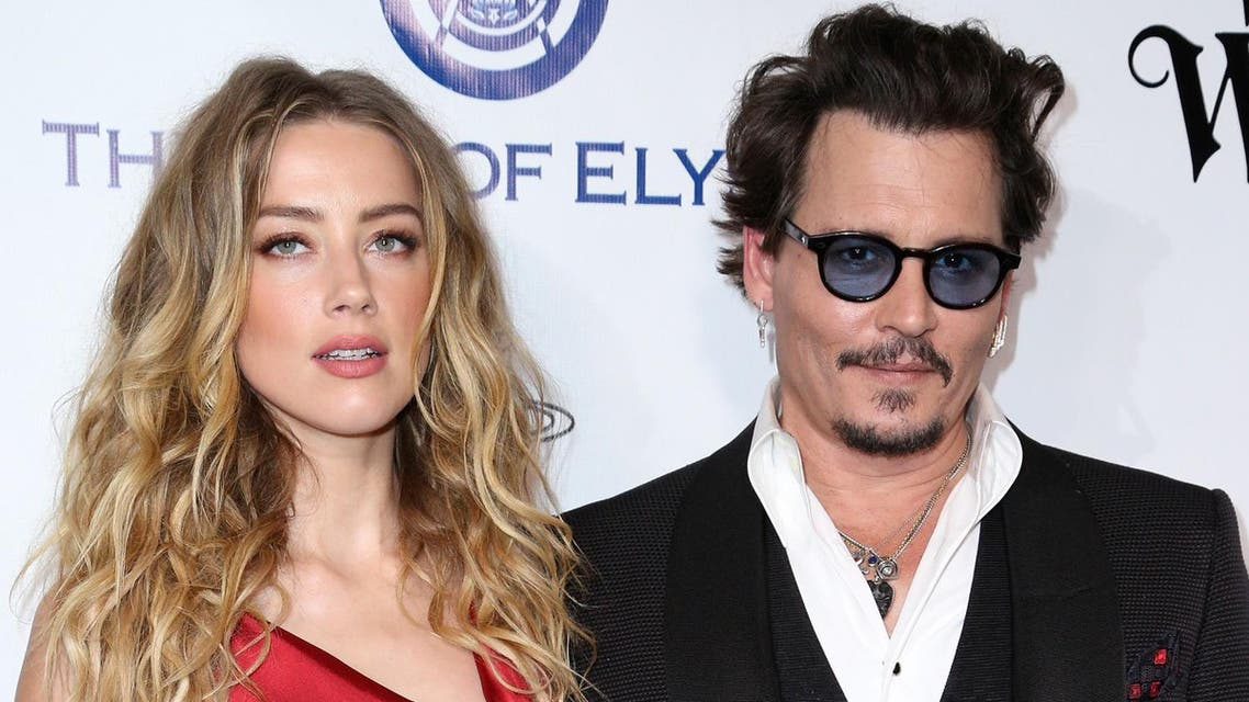In this Jan. 9, 2016 file photo, Amber Heard, left, and Johnny Depp arrive at The Art of Elysium's Ninth annual Heaven Gala at 3LABS, in Culver City, Calif. Heard was in Los Angeles Superior Court court on Friday, May 27, 2016, and provided a sworn declaration that her husband Johnny Depp threw her cellphone at her during a fight Saturday, striking her cheek and eye. The judge ordered Depp to stay away from his estranged wife and ruled that Depp shouldn't try to contact Heard until a hearing is conducted on June 17. Heard filed for divorce on Monday. (Photo by Rich Fury/Invision/AP)