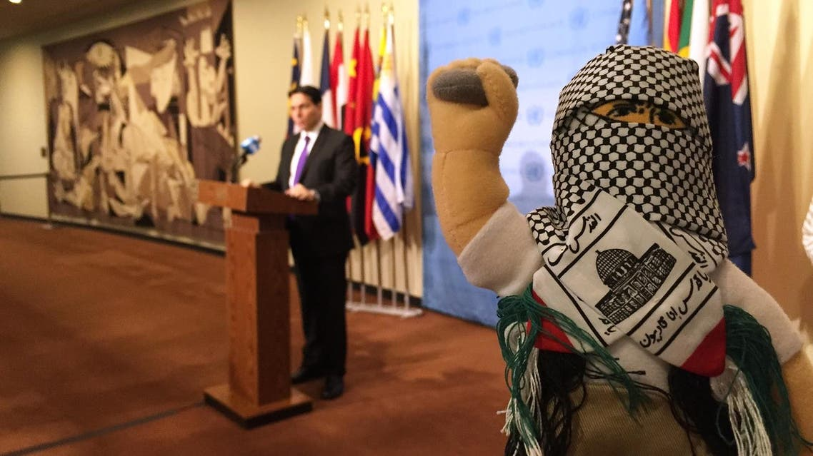 """Israel's U.N. Ambassador Danny Danon and his colleagues display what he called """"terror dolls"""" , right, that he said are being used to teach hatred among Palestinian children, Tuesday, Jan. 26, 2016, at the U.N. He spoke shortly before the U.N. Security Council met to discuss the Middle East and U.N. chief Ban Ki-moon spoke out against Israel's settlement activities. Ban told council members that the parties must """"act now to prevent the two-state solution from slipping away forever."""" (AP)"""
