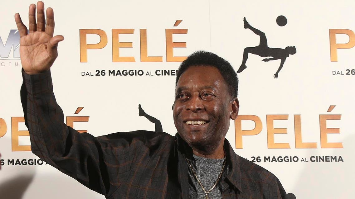Brazilian soccer legend Edson Arantes Do Nascimiento better known as 'Pele', gestures during a photocall of the movie 'Pele', in Milan, Italy, Wednesday, May 25, 2016. (AP)