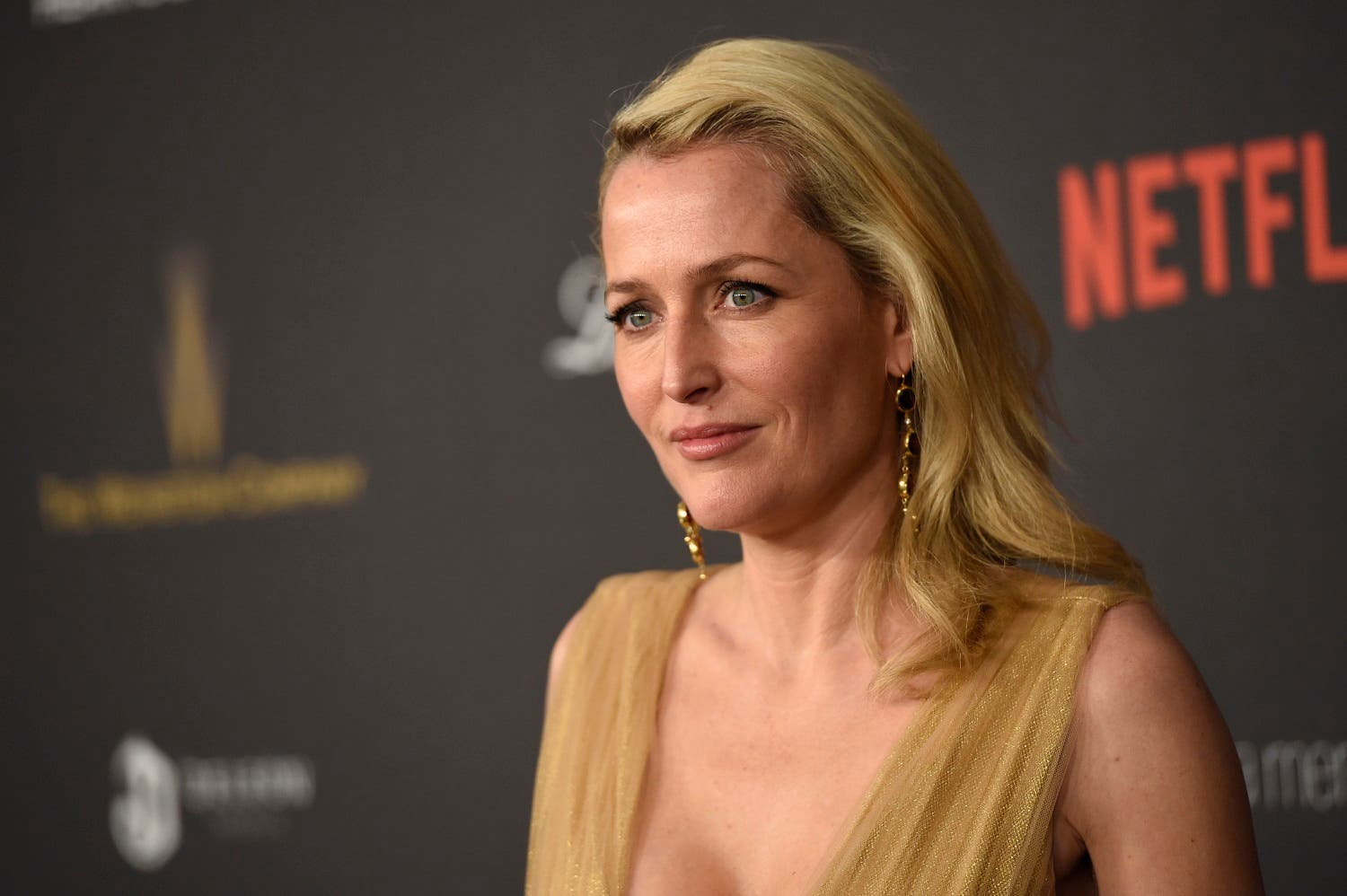Gillian Anderson arrives at The Weinstein Company and Netflix Golden Globes afterparty on Sunday, Jan. 10, 2016, at the Beverly Hilton Hotel in Beverly Hills, Calif. (Photo by Chris Pizzello/Invision/AP)