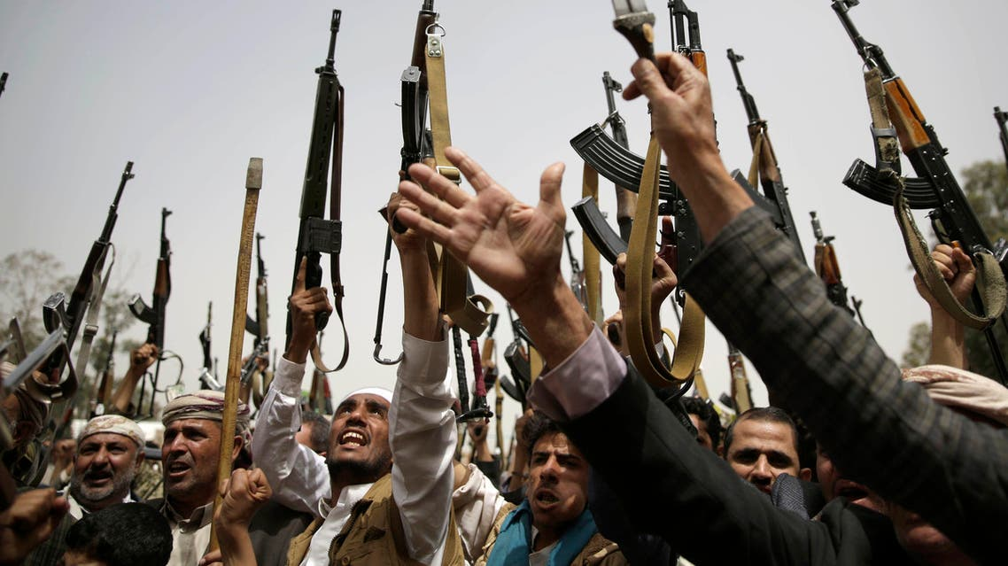 Shiite Houthi tribesmen hold their weapons as they chant slogans during a tribal gathering showing support for the Houthi movement, in Sanaa, Yemen, Thursday, May 26, 2016. (AP)