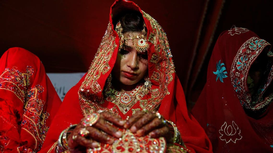 Pakistani brides attend a mass wedding ceremony in Karachi, Pakistan Monday, May 9, 2016. The mass marriage ceremony of 135 couples was organized and funded by a local non governmental organization for people who were unable to afford their own ceremony. (AP