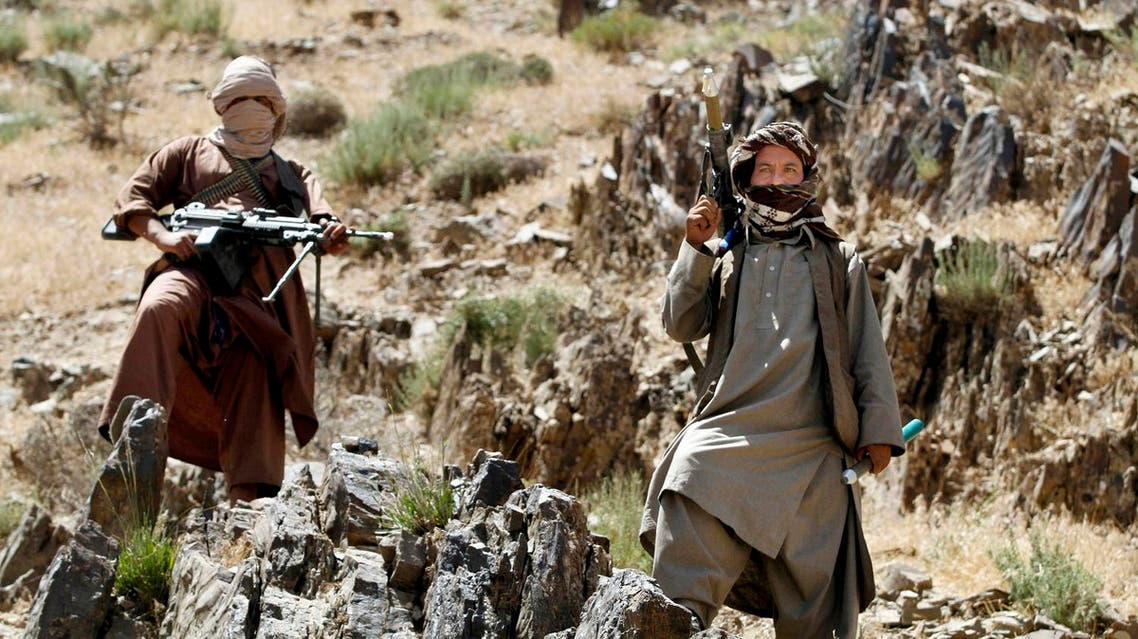 In this Friday, May 27, 2016 photo, Taliban fighters stand guard as senior leader of a breakaway faction of the Taliban Mullah Abdul Manan Niazi, not pictured, delivers a speech to his fighters, in Shindand district of Herat province, Afghanistan. Niazi said Sunday, May 29, 2016 he was willing to hold peace talks with the Afghan government but would demand the imposition of Islamic law and the departure of all foreign forces. (AP)