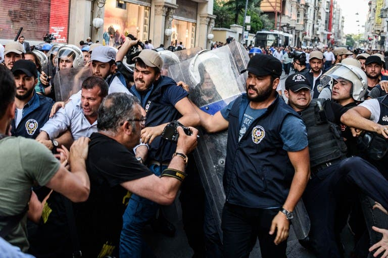 Protestors and Turkish anti-riot police clash on May 31, 2016 in Istanbul, during a demonstration commemorating the third anniversary of the start of the Gezi Park protests. (AFP)