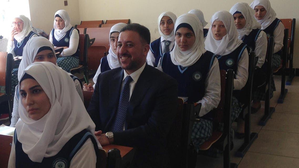 Khamis Khanjar, (C) a Sunni multimillionaire, visits displaced Sunni Iraqis at a school he funds in Iraqi Kurdistan, Iraq, February 16, 2016.reuters