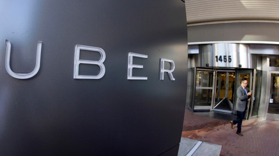 In this Dec. 16, 2014, file photo a man leaves the headquarters of Uber in San Francisco. Uber said on Wednesday, June 1, 2016, that it is getting a massive cash infusion from Saudi Arabia. (AP)