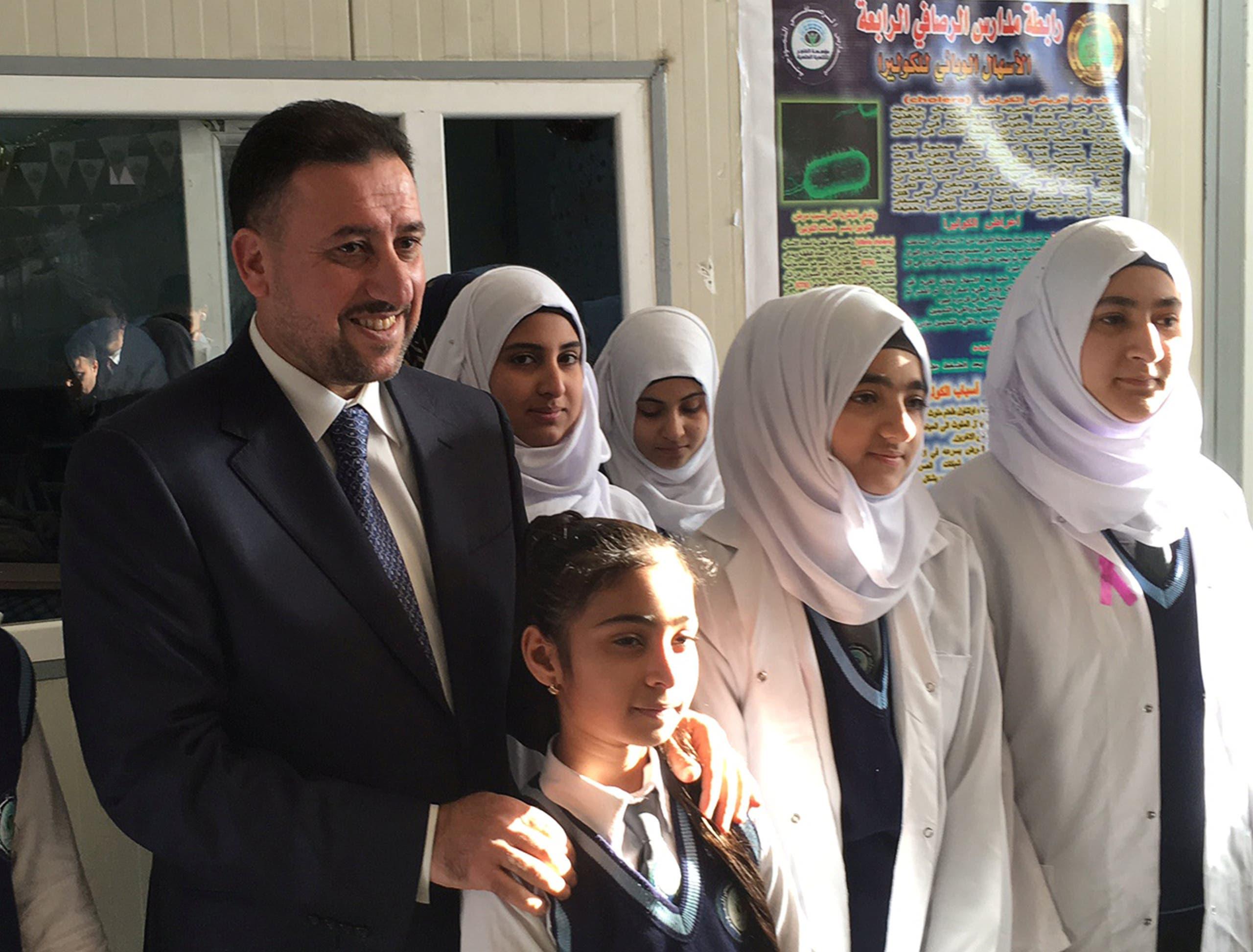 Khamis Khanjar, (L) a Sunni multimillionaire, visits displaced Sunni Iraqis at a school he funds in Iraqi Kurdistan, Iraq, February 16, 2016.