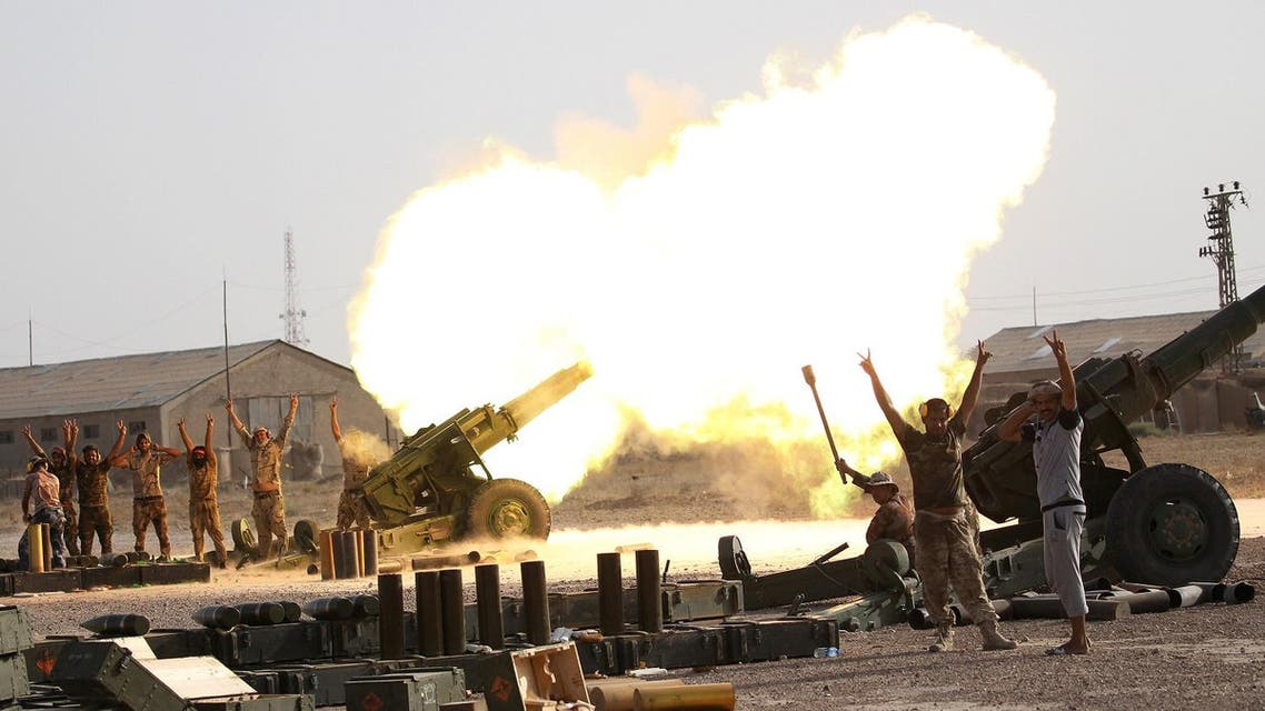 raqi security forces and Shi'ite fighter fire artillery towards ISIS militants near Fallujah. (Reuters)