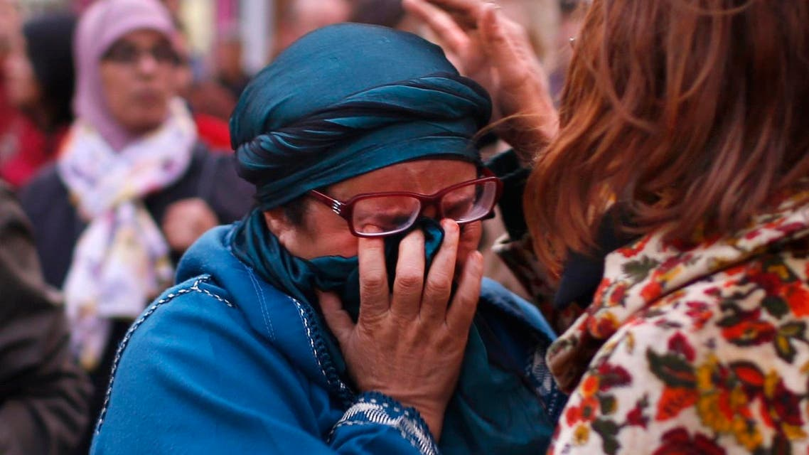 A woman is comforted as residents of the Brussels suburb of Molenbeek take part in a memorial gathering to honour the victims of the recent deadly Paris attacks. (File photo: Reuters)