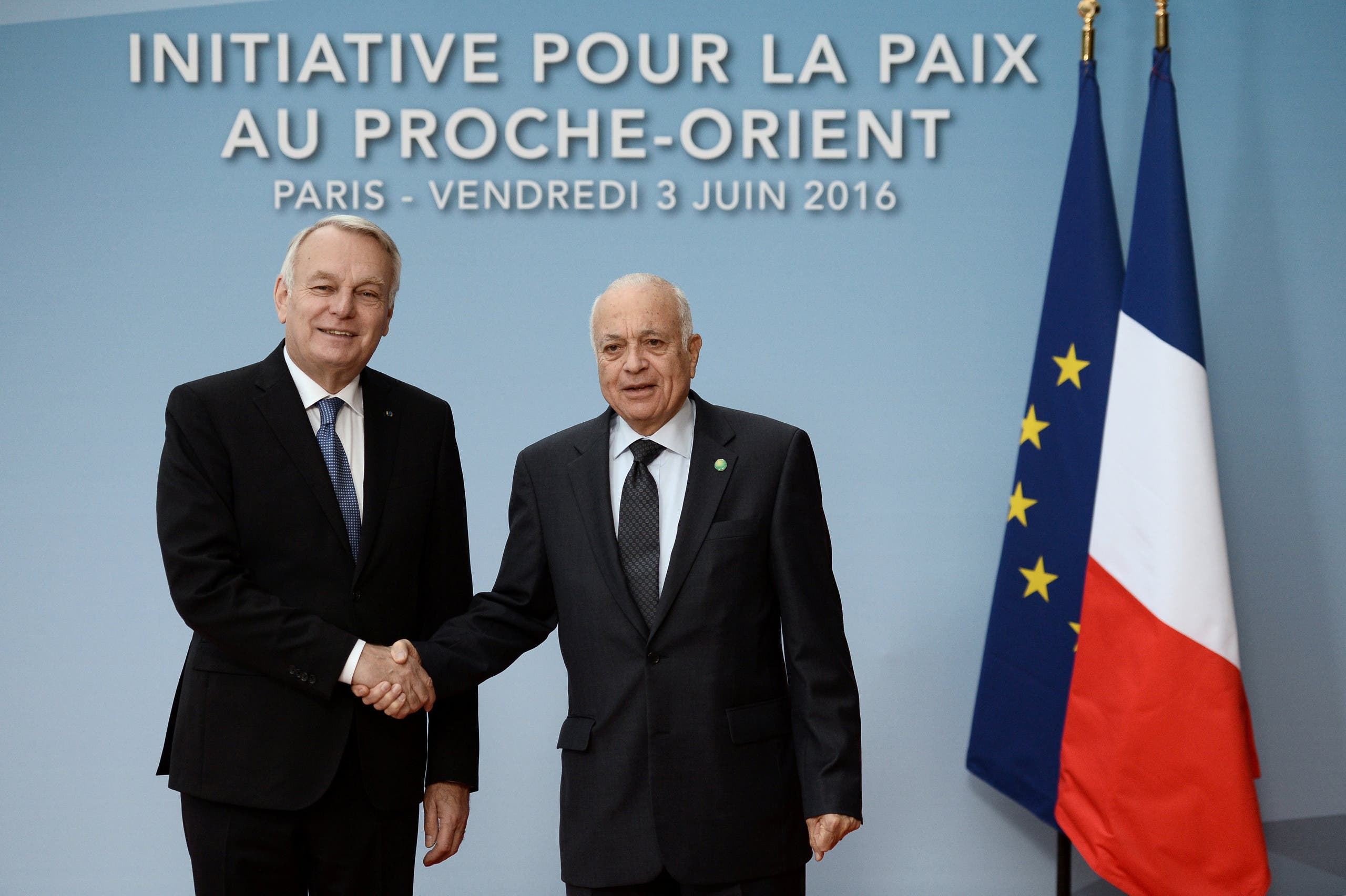 French Foreign Minister Jean Marc Ayrault (L) shakes hands with Arab League secretary-general Nabil Alarabi upon his arrival to attend an international and interministerial conference in a bid to revive the Israeli-Palestinian peace process, in Paris, France, June 3, 2016. REU