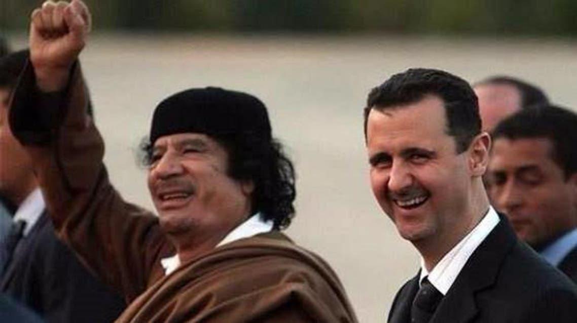 بشار الأسد والراحل معمر القذافي