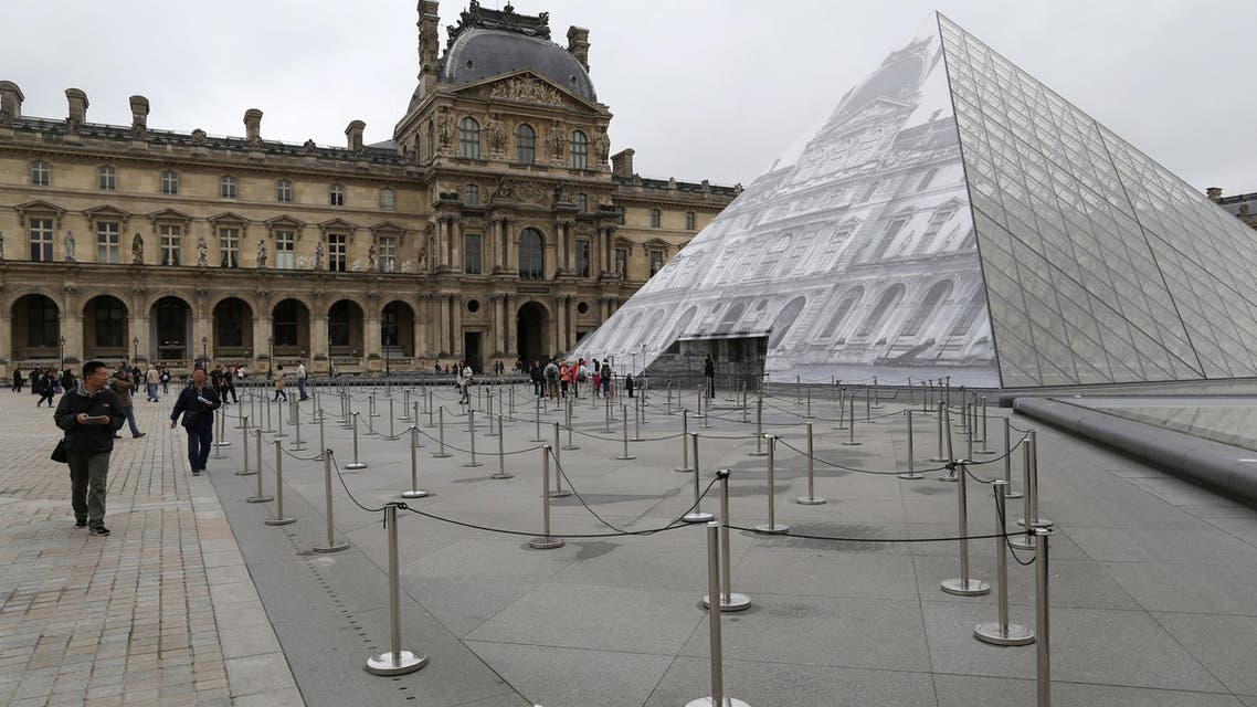 Tourists walk past empty waiting lines as the Louvre Museum is closed due to the rising Seine River in Paris, France, after days of almost non-stop rain caused flooding in the country, June 3, 2016. REUTERS/John Schults