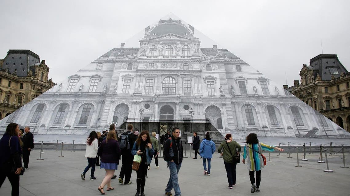 Visitors gather in front of the entrance of the Musee de Louvre which is closed and tourists being turned away, due to the unusually high water level of the nearby river Seine in Paris, Friday, June 3, 2016. (Photo: AP)