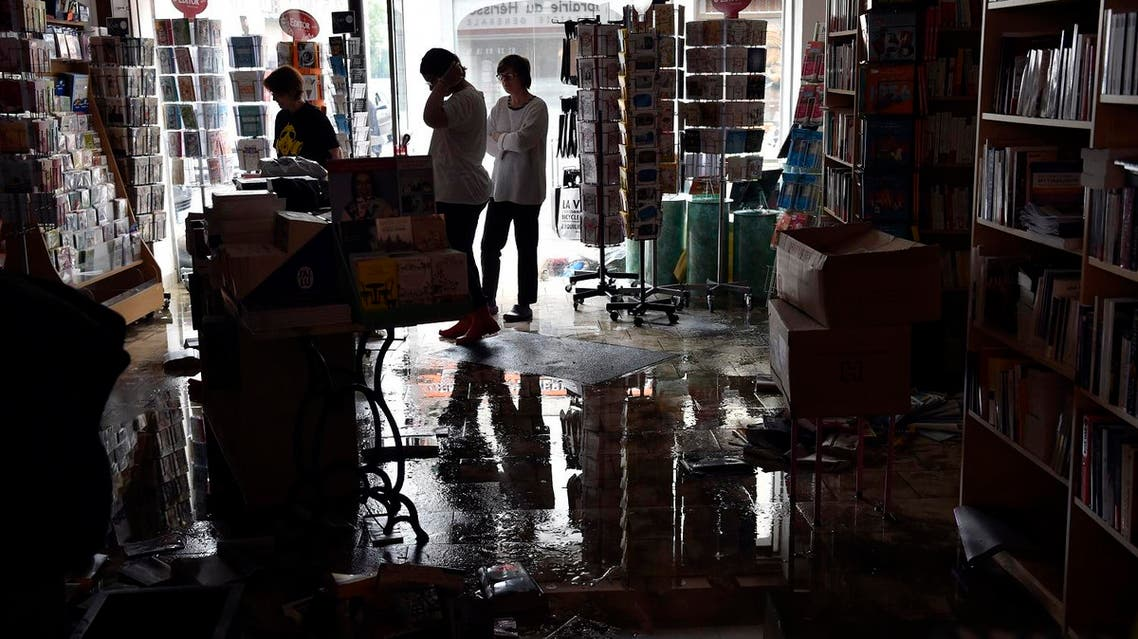 Bookstore owners clear their devastated premises following floods caused by heavy rainfalls in Montargis (Photo: Alain Jocard/AFP)