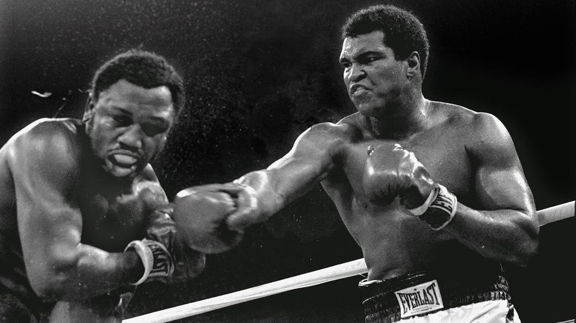 Spray flies from the head of challenger Joe Frazier as heavyweight champion Muhammad Ali connects with a right in the ninth round of their title fight in Manila, Philippines, October 1, 1975. (Photo: AP)