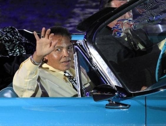 Muhammad Ali waves to the crowd during the opening ceremony of the World Equestrian Games in Lexington, Kentucky, September 2010.  (Reuters)