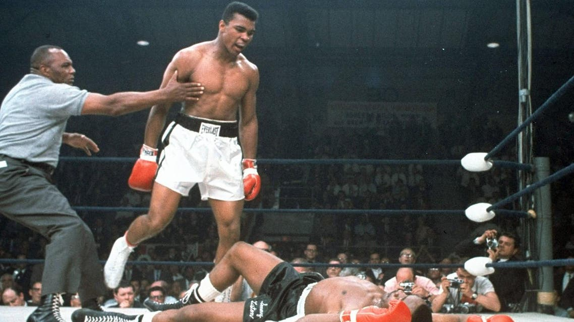 In this May 25, 1965, file photo, heavyweight champion Muhammad Ali is held back by referee Joe Walcott, left, after Ali knocked out challenger Sonny Liston in the first round of their title fight in Lewiston, Maine. Ali, the magnificent heavyweight champion whose fast fists and irrepressible personality transcended sports and captivated the world, has died according to a statement released by his family Friday, June 3, 2016. He was 74. (AP)